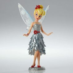 Item Number: 4053350 Material: Stone Resin Dimensions: 8.25 in H x 2.25 in W x 4.25 in L In her winter finest, Tinker Bell makes a winter debut in Disney Couture de Force. Shimmering in silver and sea