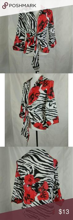 "Mishca Open Face Blouse You are buying Mishca Women's Blouse Size Large Tie Front Red with Zebra Animal Print.  3/4 sleeve in very good pre-loved condition.  96% Cotton, 4% Spandex.  Measurements are approximate Chest Chest is adjustable Sleeve 12"" Length 24.5  XW314 Mishca Tops Blouses"