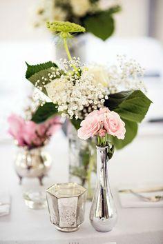 floral centerpieces http://www.weddingchicks.com/2013/09/13/pink-and-mint-wedding/