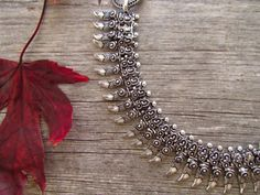 Pirate Dagger Tribal Metal Necklace Metal Necklace by LaMirraFashion This metal necklace has cute little pirate dagger on a beautifully carved chain with equally intricate design. Perfect for an evening out ! It is also very light weight.