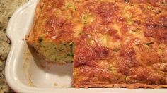 This zucchini pie, made with eggs, cornbread mix, and Cheddar cheese, is a cross between cornbread and a pie and perfect for brunch or dinner.