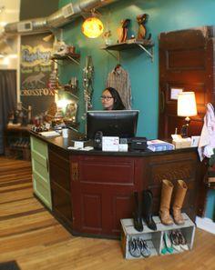 Pageboy Salon  Boutique in Lawrenceville…reclaimed door retail desk.