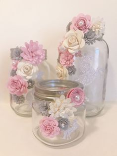 paper flower centerpieces Beautiful mason jars decorated with paper flowers. You can customize what color flowers you want. Great for centerpieces or gifts! Most popular for h Mason Jar Crafts, Bottle Crafts, Mason Jars, Crafts With Jars, Paper Flower Centerpieces, Paper Flowers Diy, Shower Centerpieces, Wedding Centerpieces, Diy Paper