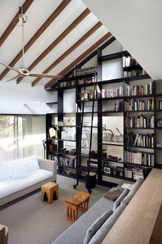 Black bookshelf with ladder