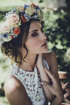 Flower crown and updo wedding hairstyle