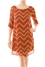 Just discovered @Longhorn Fashions and will have to check them out! Burnt Orange and White Chevron Dress $48.00 www.longhornfashions.com