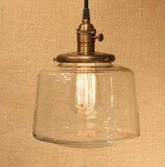 Pendant Lighting With Tapered Clear Glass Shade and Exposed Socket Design. $148.00, via Etsy.