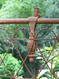 Heart shaped wrought iron and wire fence on an abandoned property. ♥