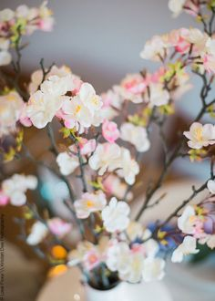 Looking for pink wedding flowers or spring blooms? Check out this beautiful, artificial apple blossom branch spray in pink cream. This lovely pink apple blossom spray would look stunning in a tall vase arrangement, or clip down and use in bouquets for a touch of spring!
