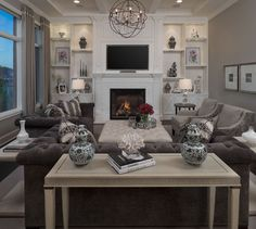 Northville MI - Family room New Construction, Custom furnishings through out, Custom lighting, carpeting, dressmaker drapery, Custom designed fireplace with built in shelving and cabinetry, Coffered ceiling.