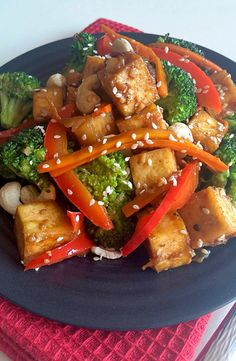 A healthy dinner of stir fry tofu and vegetables seasoned with chilli and ginger is what's on your dinner menu tonight! Vegetarian Main Dishes, Vegan Dishes, Food Dishes, Vegetarian Recipes, Healthy Recipes, Tofu Stir Fry, Chicken Stir Fry, Fried Chicken, Wok Recipes