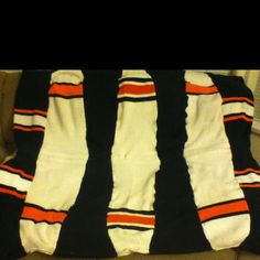 Hockey sock blanket. Saw a better one in CR. cut socks into squares and back with fleece. Great on Ryan's bed