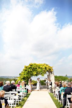 love the flowers/view (Austin wedding at Vintage Villas on the lake)