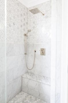 Hex tiles on the floor? Exquisite shower features marble hex tiles on upper walls and stacked marble tiles on lower walls . Marble Tile Bathroom, Bathroom Flooring, Marble Tiles, Hexagon Tiles, Bathroom Canvas, Master Shower Tile, Mosaic Shower Tile, Shower Tile Designs, Gold Bathroom