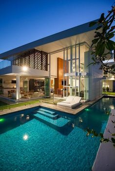 Cali hollywood house with wraparound pool and clean lines, flat roof; mid-century modern