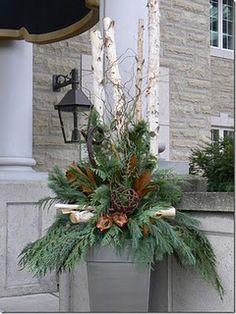 front porch arrangement-mix birch logs, pinecones, magnolia, greenery