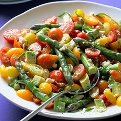 Cherry Tomato and Asparagus Salad  This simple side dish is a great contribution to a potluck. We suggest you keep the dressing separate until ready to serve.