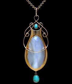 MURRLE BENNETT & Co. (1896-1914)   A gold pendant set with a central pearl plaque with a turquoise set above, flanked  by wirework entrelac motifs. A turquoise drop below.  Anglo/German c.1900. Marks for MB & Co. and 15 ct. (Pendant case)  Size: Length of pendant with bale 6.7 cm. Without bale 6 cm. Width 2.3 cm.   Lit.: Art Nouveau Jewelry. Vivienne Becker. Liberty Style. Academy Editions | JV