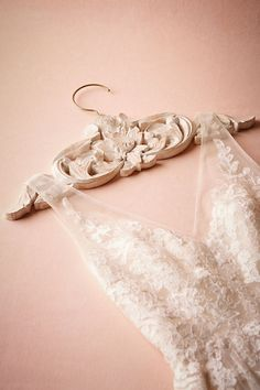 Discover BHLDN, sister brand of Anthropologie. Explore our collection of unique wedding gifts. Indulge tradition with our beautiful vintage wedding gifts. Wood Hanger, Hangers, Wedding Dress Hanger, Wedding In The Woods, Balinese, How To Antique Wood, Bride Gifts, Bridal Accessories, Wedding Stationery