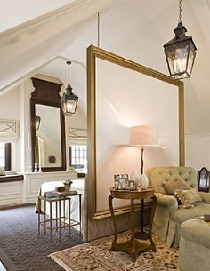 oversized mirror hung to separate two rooms....great for large room that needs to be divided - like a studio apt.