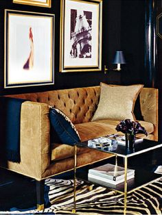 Beautiful Eclectic Chic Living Room....zebra rug, camel sofa, black walls, black and brass coffee table.