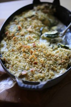 Zucchini gratin in a velvety smooth bechamel sauce, gooey Gruyere cheese topped with crunchy breadcrumbs. The results are just sublime!     #entertainingwithbeth #ZucchiniRecipes #ZucchiniGratin #French Recipes Zucchini Gratin, Zucchini Casserole, Bake Zucchini, Side Dish Recipes, Vegetable Recipes, Vegetarian Recipes, French Sauces, Classic French Dishes, Dinner Side Dishes