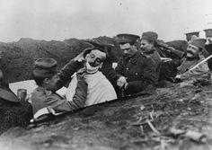 A soldier gets a shave in a Serbian trench, 1916