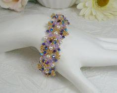 Bracciale intrecciato in Swarovski ABx2 lavanda e viola martellata perle