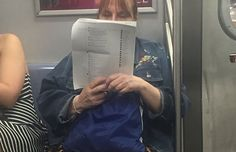 A Woman On The Subway Printed Out 15 Pages Of Facebook Posts And Is Just Reading The Comments
