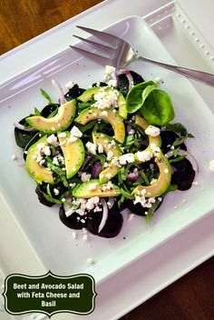 Slice beets, avocado, and spicy red onion on a plate with leafs of fresh basil and feta cheese to make this healthy beet salad in minutes.