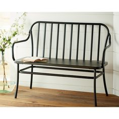 If you strolled through the cafés, ice cream parlors or parks of days gone by, you would see these quaint metal Park Benches tucked around. We've recreated them for today's home in Blackened Bronze to add an accent color to your room. Rounded framed with metal spindle back Round tubular metal frame Sheet metal seat Blackened Bronze finish