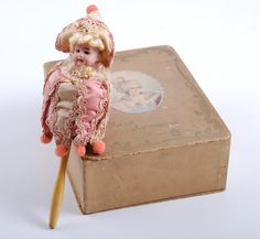 Marie Antoinette music box.... music plays while spinning the doll.    Live auctions