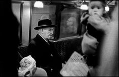 Bruce Davidson - London. 1960. Man on tube surrounded by babies.