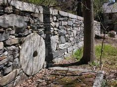wall at Harvard Shaker Village with mill stone