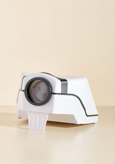 You'll have the power to display images for all to see when you employ this smartphone projector to turn your wall into an oversized screen! Wireless, battery-free, and equipped with an adjustable lens to ensure a perfect picture, this ingenious gadget only needs to have a phone popped inside to make its projection possible.
