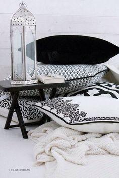moroccan lantern with black & white pillows