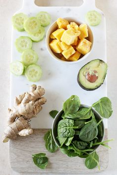 A creamy and healthy detox green smoothie recipe! Made with mango, ginger, cucumber, spinach and avocado. So tropical and refreshing!