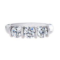 Gordon James 3 stone Round Brilliant Cut Diamond ring; 1.58 carat total weight. Set in platinum. http://www.gordonjamesdiamonds.com/products/diamond-rings/tsr-843