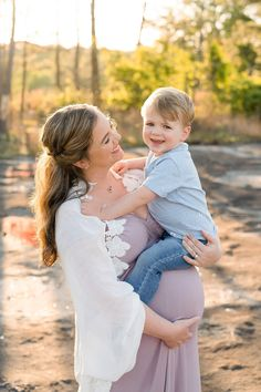 Smiling Mother-to-be as she stands holding her toddler son in one arm with her other arm around her belly on a mountain in Atlanta at sunset by Lily Sophia Photography. Maternity Photo Outfits, Family Maternity Photos, Fall Maternity, Maternity Pictures, Pregnancy Photos, Family Posing, Family Portraits, Maternity Photography Poses, Toddler Photography