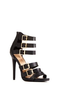Love the strappy look! Wish the heel was a little shorter though.