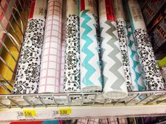 adhesive wallpaper roll $3. office chic supplies at Target Dollar Section.. the spot!!!! give your cubicle or work desk a glam makeover for dirt cheap. obsessed with the studded thumb tacks and patterned file folders <3 via thebeetique.blogspot.com