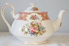 Beautiful vintage English Bone China large size teapot in the famous Lady Carlyle design, a beautiful pattern in pink and multicolor flowers. Marked Royal Albert, Bone China, England Lady Carlyle. This design dates from the sixties. In good condition without chips or cracks, at the