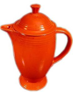 fiesta coffee pot . made in all colors except medium green and was in production form 1936 until the middle of 1956 . the coffee pot was reintroduced in 1969 in ironstone and amberstone