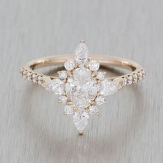 Rose gold vintage ballerina engagement ring. Marquise oval diamond with hidden…