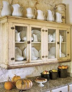 Vintage vases and dishes stored in this gorgeous rustic cabinet give this fall themed kitchen an inviting look Do you need a little inspiration for your kitchen? These French country kitchens are all stunning examples of country farmhouse style decor. French Country Kitchens, Country Farmhouse Decor, French Country House, Farmhouse Style Decorating, French Country Decorating, Country Bathrooms, French Cottage, European House, Primitive Country