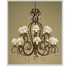"""10134-48-C  SIXTEEN LIGHT TWO TIER IRON CHANDELIER CRYSTAL: SHOWN WITH IMPORTED FACETED CRYSTAL, AVAILABLE WITH CUT CRYSTAL  FINISH SHOWN: NATURAL RUST SHADE: 3X7X4  WITH WHITE WAX CANDLE MAXIMUM WATTAGE: 960 CANDELABRA BASE SOCKETS HT 52"""" WITH CRYSTAL HT 46"""" W/O CRYSTAL W 48"""" WT. APPROX. 60 LBS. REQUIRES REINFORCED J-BOX"""