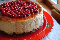 Eggnog Cheesecake with Gingersnap Crust & Pomegranate Glaze