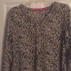 Lightweight, soft, long sleeve blouse. Diva by Dana Buckman cream and black blouse with beautiful scalloping around the neck. Worn one time. Dana Buchman Tops Blouses