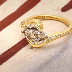 A stunning combination of champagne and white diamonds in swirls of yellow gold. #NinasSaysLove #ninasjewellery #champagne