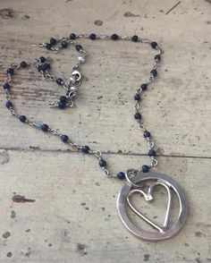 An encircled heart on blue lapis beads. #momjewelry #mothersdayjewelry #mothersday